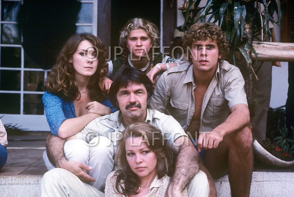 Vassouras, district of Rio de Janeiro, Brazil. 1981.  A family in Africa is besieged by a group of lions, driven mad by the drought. They have to survive multiple attacks but some of their colleagues are eaten by the lions. From the film Savage Harvest, directed by Robert E. Collins. Photo of the stars: Tom Skerritt, Michelle Phillips, Anne-Marie Martin, Tana Helfer and Derek Partridge.