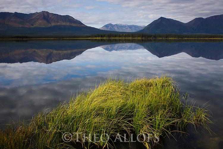 Canada, Yukon, Kluane Region, Kluane Mountains reflected in calm lake, fall