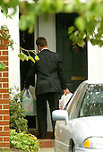 """Arlington, VA - October 15, 2002 -- A friend brings groceries to the home of """"Beltway Sniper"""" victim Linda Franklin at 2808-B Wakefield Street; Arlington, VA. <br /> Credit: Ron Sachs / CNP<br /> (RESTRICTION: NO New York or New Jersey Newspapers or newspapers within a 75 mile radius of New York City)"""