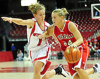 Wisconsin freshman Jamie Russell (left) chases down River Falls' Jenna Hanson. Russell leads the Badgers with 15 points, as the women's basketball team tops UW-River Falls in a 71-38 exhibition win on Sunday at the Kohl Center in Madison