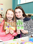 Kellie Kate Ferris and Rachel Smith pictured at the childrens St. Patrick's Day and Easter art workshop held in the Library. Photo:Colin Bell/pressphotos.ie