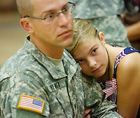 deployment0724 159900-- Olivia Hewitt, of Scottsdale, rests her head on her father Brandon Hewitt's shoulder before he deployed Thursday with the Phoenix-based 3666th Support Maintenance Company. The Arizona troops will head to Camp Atterbury, Ind., for 30-45 days of training and.then travel to Iraq.  (Pat Shannahan/ The Arizona Republic)