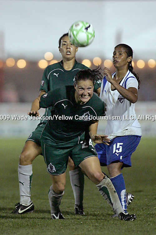 01 Aug 2009: Kendall Fletcher (24) of Saint Louis Athletica  gets her head on the ball as Fabiana (15) of the Breakers and Stephanie Logterman (3) of Saint Louis Athletica enter the area.  Saint Louis Athletica defeated the visiting Boston Breakers 1-0 in a regular season Women's Professional Soccer game at Anheuser-Busch Soccer Park, in Fenton, MO.
