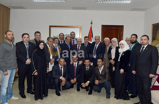 Palestinian Mahmoud Abbas meets with Palestinian community delegation from UAE, in the West Bank city of Ramallah, on April 1, 2013. Photo by Thaer Ganaim