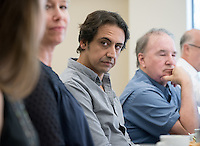 Kareem Fahim '93, foreign correspondent for The New York Times, has lunch with Diplomacy & World Affairs students in Professor Derek Shearer's class, Feb. 24, 2016 in JSC.<br />