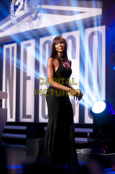 Naomi Campbell.The 20th Unesco charity gala at Maritim Hotel, Duesseldorf, Germany..November 19th, 2011.full length black dress.CAP/PPG/JH.©Jens Hartmann/People Picture/Capital Pictures