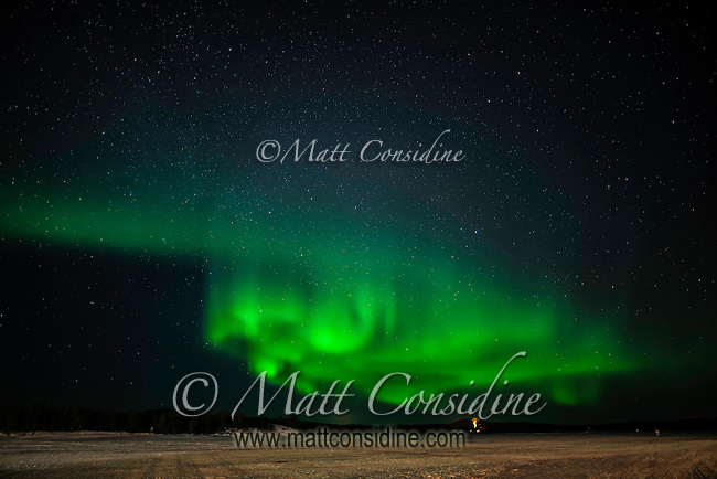 Curtain of aurora over ice lake, (Photo by Travel Photographer Matt Considine)