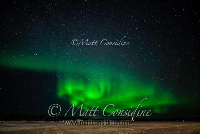 Curtain of aurora over ice lake, (Photo by Travel Photographer Matt Considine)