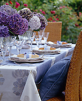 A colour scheme based around purple hydrangeas has been used as the inspiration for this summer dining table