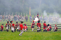British redcoats defend against the Continental Army and militiamen at a Revolutionary War encampment, Old Sturbridge Village, Massachusetts, USA.