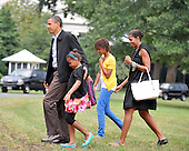 Washington, D.C. - August 30, 2009 -- United States President Barack Obama and his family return to the White House after a week's vacation in Martha's Vineyard in Massachusetts on Sunday, August 30, 2009.   From left to right: President Obama, Sasha Obama, Malia Obama, and first lady Michelle Obama..Credit: Ron Sachs / Pool via CNP