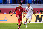 Nguyen Tien Linh of Vietnam (L) fights for the ball with Salem Alajalin of Jordan (R) during the AFC Asian Cup UAE 2019 Round of 16 match between Jordan (JOR) and Vietnam (VIE) at Al Maktoum Stadium on 20 January 2019 in Dubai, United Arab Emirates. Photo by Marcio Rodrigo Machado / Power Sport Images