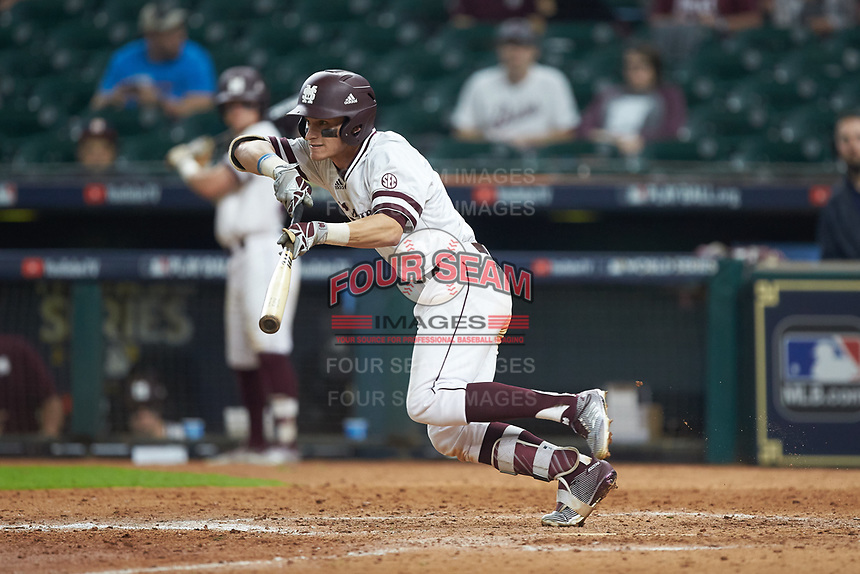 Jake Mangum (15) of the Mississippi State Bulldogs attempts a bunt during the game against the Houston Cougars in game six of the 2018 Shriners Hospitals for Children College Classic at Minute Maid Park on March 3, 2018 in Houston, Texas. The Bulldogs defeated the Cougars 3-2 in 12 innings. (Brian Westerholt/Four Seam Images)