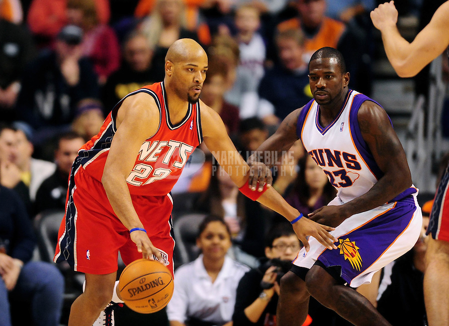 Jan. 20, 2010; Phoenix, AZ, USA; New Jersey Nets forward (22) Jarvis Hayes controls the ball against Phoenix Suns forward (23) Jason Richardson at the US Airways Center. The Suns defeated the Nets 118-94. Mandatory Credit: Mark J. Rebilas-