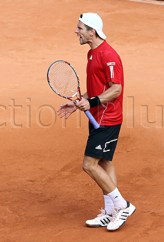Austria's Juergen Melzer returns a ball to Kazakhstan's Andrey Golubev during their ATP German Open finals match at Rothenbaum club in Hamburg, Germany, 25 July 2010.