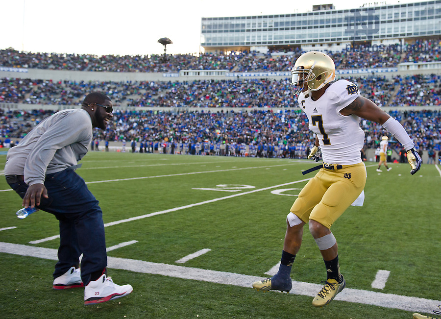 Oct. 26, 2013; TJ Jones (7) celebrates with former player Kapron Lewis-Moore (left) after Jones scored a touchdown in the third quarter.