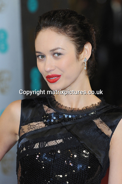 NON EXCLUSIVE PICTURE: PAUL TREADWAY / MATRIXPICTURES.CO.UK.PLEASE CREDIT ALL USES..WORLD RIGHTS..French actress Olga Kurylenko attending the 2013 EE British Academy Film Awards, at London's Royal Opera House...FEBRUARY 10th 2013..REF: PTY 13945