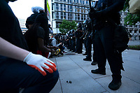 Demonstrators kneel before police during a protest in Washington, D.C., U.S., on Sunday, May 31, 2020, following the death of an unarmed black man at the hands of Minnesota police on May 25, 2020.  Credit: Stefani Reynolds / CNP/AdMedia