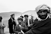 Northern Afghanistan<br /> October 2001<br /> <br /> Mr. John Weaver oversees the selection of workers for Shelter for Life's work for food program. Each ten days a new group is selected and will be paid with food, 6KG of wheat a day.