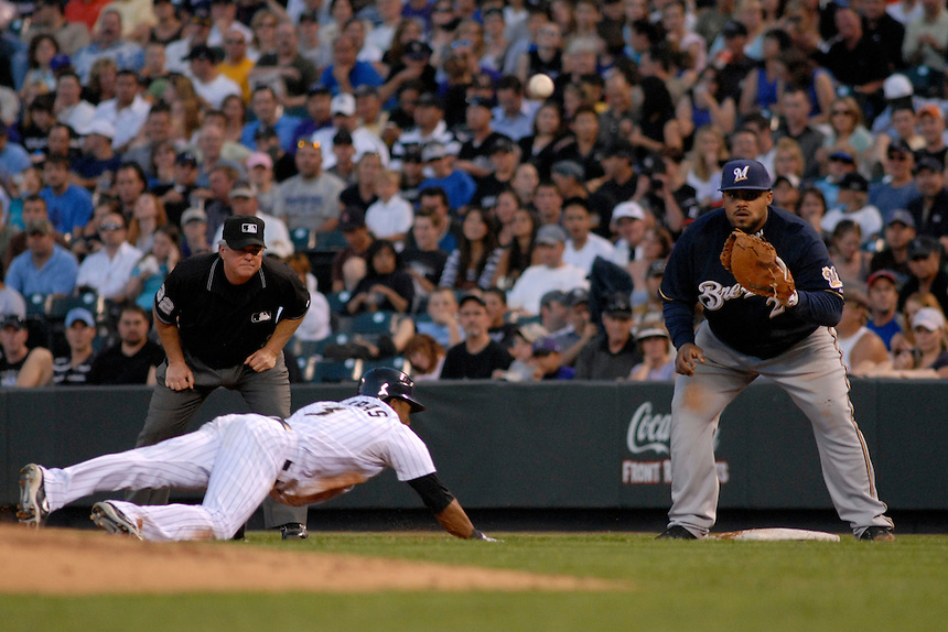 06 June 08: Milwuakee Brewers 1st baseman waits on a pickoff attempt while Colorado Rockies outfielder Willy Taveras dives back to 1st base. Taveras was safe on the play. The 1st base umpire is Dana DeMuth. The Rockies defeated the Brewers 6-4 at Coors Field in Denver, Colorado on June 6, 2008. For EDITORIAL use only