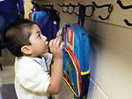 The Gazette. Steven Pinera, 4 of Laurel, makes sure his backpack stays on the hook during the morning of his first day of pre-kindergarten at James H. Harrison Elementary School in Laurel on Monday.