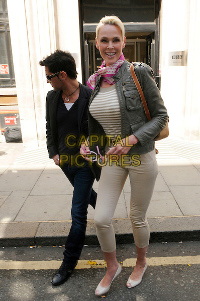 MATTIA DESSI & BRIGITTE NIELSEN.At BBC Radio 2, London, England..May 4th, 2011.full length beige cropped trousers white stripes striped top pink scarf neckerchief khaki jacket jeans denim black married husband wife .CAP/IA.©Ian Allis/Capital Pictures.