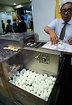 June 8, 2016, Tokyo, Japan - Japanese food machinery maker EGG displays boiled egg shell peeling machine at the International Food Machinery and Technology Exhibition in Tokyo on Wednesday, June 8, 2016. 688 Japanese and foreign food machinery companies are exhibiting their latest technology and products in the four-day trade show.   (Photo by Yoshio Tsunoda/AFLO) LWX -ytd-