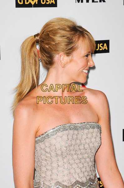 TONI COLLETTE.The G'Day USA Australia Week 2010 Black Tie Gala in the Grand Ballroom at Hollywood & Highland in Hollywood, California, USA.  .January 16th, 2010.half length  fringe hair up strapless beaded beads beige silver side ponytail profile.CAP/ROT.©Lee Roth/Capital Pictures.