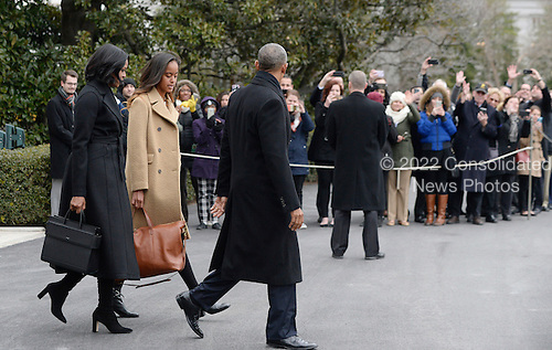 United States President Barack Obama with First Lady Michelle Obama and daughter Malia walk on the South Lawn toward marine One to depart the White House ,  January 10, 2017 in Washington, DC. The President is traveling to Chicago to deliver his farewell address to the American people. <br /> Credit: Olivier Douliery / Pool via CNP