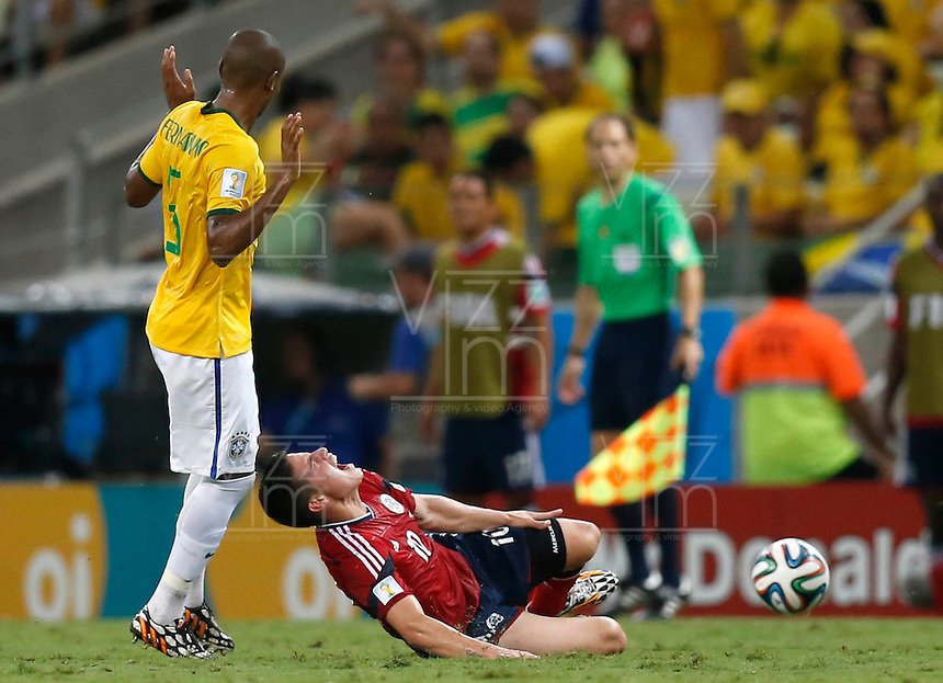 FORTALEZA - BRASIL -04-07-2014. Foto: Daniel Jayo / Archivolatino<br /> James Rodriguez (#10) jugador de Colombia (COL) recibe falta de Fernandinho (#5) jugador de Brasil (BRA) durante partido de los cuartos de final por la Copa Mundial de la FIFA Brasil 2014 jugado en el estadio Castelao de Fortaleza./ James Rodriguez (#10) player of Colombia (COL)received a foul from Fernandinho (#5) player of Brazil (BRA) during the match of the Quarter Finals for the 2014 FIFA World Cup Brazil played at Castelao stadium in Fortaleza. Photo:  Daniel Jayo / Archivo Latino<br /> VizzorImage PROVIDES THE ACCESS TO THIS PHOTOGRAPH ONLY AS A PRESS AND EDITORIAL SERVICE IN COLOMBIA AND NOT IS THE OWNER OF COPYRIGHT; ANOTHER USE IS REPONSABILITY OF THE END USER. NO SALES, NO MERCHANDASING. ALL COPYRIGHT IS ARCHIVOLATINO