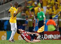 FORTALEZA - BRASIL -04-07-2014. Foto: Daniel Jayo / Archivolatino<br /> James Rodriguez (#10) jugador de Colombia (COL) recibe falta de Fernandinho (#5) jugador de Brasil (BRA) durante partido de los cuartos de final por la Copa Mundial de la FIFA Brasil 2014 jugado en el estadio Castelao de Fortaleza./ James Rodriguez (#10) player of Colombia (COL)received a foul from Fernandinho (#5) player of Brazil (BRA) during the match of the Quarter Finals for the 2014 FIFA World Cup Brazil played at Castelao stadium in Fortaleza. Photo:  Daniel Jayo / Archivo Latino<br /> VizzorImage PROVIDES THE ACCESS TO THIS PHOTOGRAPH ONLY AS A PRESS AND EDITORIAL SERVICE IN COLOMBIA AND NOT IS THE OWNER OF COPYRIGHT; ANOTHER USE IS REPONSABILITY OF THE END USER. NO SALES, NO MERCHANDASING. ALL COPYRIGHT IS ARCHIVOLATINO
