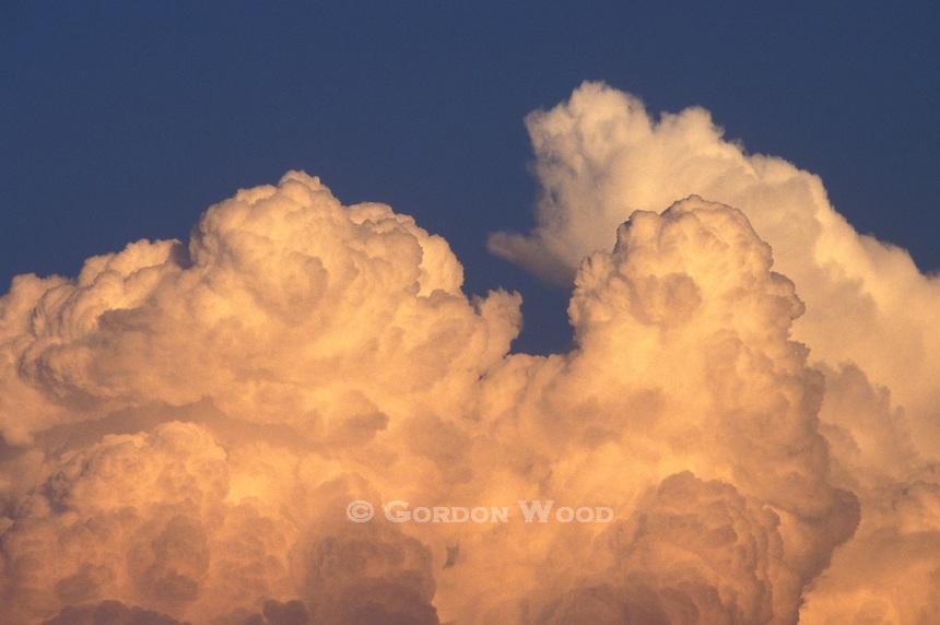 Threatening Cumulonimbus Cloud Building Against Blue Sky