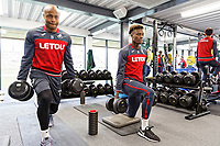 (L-R) Andre Ayew and Tammy Abraham exercise in the gym during the Swansea City Training at The Fairwood Training Ground, Swansea, Wales, UK. Wednesday 21 February 2018