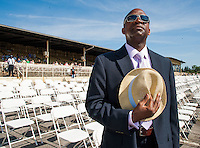 Ronn Jackson, from Washington, DC, removes his hat while listening to the National Anthem on Preakness Day at Pimlico Race Course on May 19, 2012