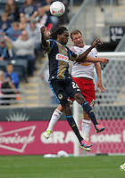 CHESTER, PA - OCTOBER 27, 2012:  Keon Daniel (26) of the Philadelphia Union up for a header against  Teemu Tainio (6) of the New York Red Bulls during an MLS match at PPL Park in Chester, PA. on October 27. Red Bulls won 3-0.