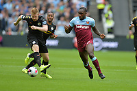 Michail Antonio andKevin De Bruyne of Manchester City during West Ham United vs Manchester City, Premier League Football at The London Stadium on 10th August 2019