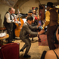 Alain Marquet (clarinet), Bernard Brimeur (double bass),  Osiris Germain (tap dancer), Sylvia Howard (vocal) and Jelly Germain (tap dancer) at a jazz concert by the Fantastic Harlem Drivers at the Petit Journal St Michel, Paris, Saturday 19th April 2014. The Fantastic Harlem Drivers consist of pianist Lou Lauprete, clarinetist Alain Marquet, double bass player Bernard Brimeur, and vocalists Sylvia Howard and Nicolle Rochelle, accompanied by tap-dancers Jelly Germain, his son Osiris Germain and Caroline Podetti. Lou Lauprete and Alain Marquet are regulars at Paris Boogie Speakeasy, the  private Parisian jazz club founded and run by Yves Riquet. Sylvia Howard sings with the Duke Ellington orchestra and the Black Label Swingtet, each led by saxophone player Christian Bonnet. Nicolle Rochelle is an internationally known singer, dancer, and actress, the star of Jerome Savary's 'Josephine' which ran for four years in France and Europe, in which Nicolle took the lead role as Josephine Baker. The evening was also attended by Yves Riquet (Sponsor and founder of Paris Boogie Speakeasy) and Jean-Paul Amouroux introduced as the finest player of Boogie-Woogie in Europe. The Fantastic Harlem Drivers were recently recorded for a new CD at Paris Boogie Speakeasy, 256 Rue Marcadet, Paris. Saturday 19th April 2014.