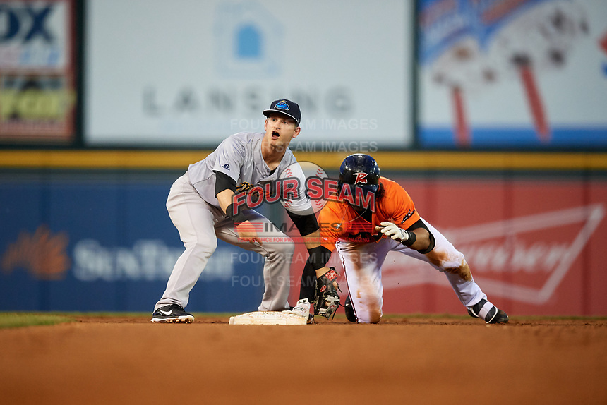 Trenton Thunder second baseman Bruce Caldwell (12) puts a tag on Ronnie Jebavy (1) as he holds on to second base during a game against the Richmond Flying Squirrels on May 11, 2018 at The Diamond in Richmond, Virginia.  Richmond defeated Trenton 6-1.  (Mike Janes/Four Seam Images)