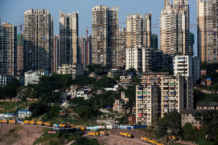 Apartment buildings stand among construction in northeastern Chongqing, China.