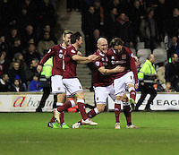 Ricky Holmes of Northampton celebrates his teams fourth goal during the Sky Bet League 2 match between Luton Town and Northampton Town at Kenilworth Road, Luton, England on 12 December 2015. Photo by Liam Smith/Prime Media Images.