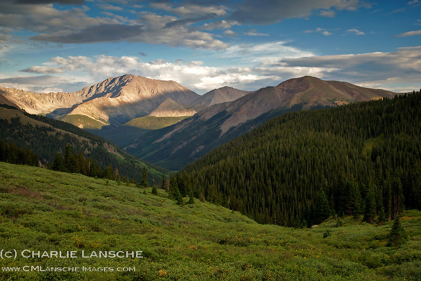 Afternoon sunlight illuminates the 14,361 foot crest of La Plata Peak in Colorado's Sawatch Range.  I retreated to my tent in Graham Gulch, near the bottom of the canyon, for a crisp night filled with echoing thunder and soft rain. August 2013. (c) Charlie Lansche/C.M. Lansche Images