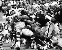 Raiders stop O.J. Simpson. (photo by Ron Riesterer)