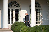 United States President Barack Obama and Vice President Joe Biden, walk on the Colonnade after observing a moment of silence for the 12 anniversary of the 9/11 terrorist attacks, at the White House on September 11, 2013 in Washington, D.C.<br /> Credit: Kevin Dietsch / Pool via CNP