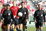 29 January 2006: Match Referee Oscar Ruiz Acosta (with), of Colombia, is flanked by assistant Eduardo Botero Walker (l), of Colombia, and Fourth Official Kevin Stott (r), of the United States. The United States Men's National Team defeated their counterparts from Norway 5-0 at the Home Depot Center in Carson, California in a men's international friendly soccer game.