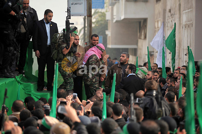 Abu Obaida, the spokesman for the Ezzedine Al-Qassam Brigades, Hamas's armed wing, attends during rally marking the 27th anniversary of Hamas' founding, in Gaza City December 14, 2014. Photo by Ashraf Amra