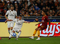 Justin Kluivert of AS Roma  and Lucas Vazquez of Real Madrid  during the Champions League Group  soccer match between AS Roma - Real Madrid  at the Stadio Olimpico in Rome Italy 27 November 2018