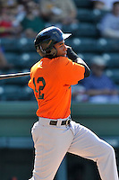 Designated hitter Junior Arias (12) of the Augusta GreenJackets bats in a game against the Greenville Drive on Sunday, June 12, 2016, at Fluor Field at the West End in Greenville, South Carolina. Greenville won, 11-8. (Tom Priddy/Four Seam Images)