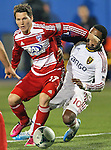 FC Dallas defender Zach Loyd (17) and Real Salt Lake forward Robbie Findley (10) in action during the game between the FC Dallas and the Real Salt Lake at the FC Dallas Stadium in Frisco,Texas...