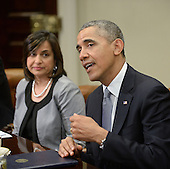 United States President Barack Obama flanked by Ravila Gupta, president of Umicore USA speaks to business leaders from across the country and around the world to discuss the importance of investing in and creating well-paying jobs in the U.S. in the Roosevelt Room of the White House May 20, 2014 in Washington, DC. <br /> Credit: Olivier Douliery / Pool via CNP