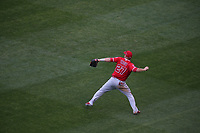 OAKLAND, CA - APRIL 6:  Mike Trout #27 of the Los Angeles Angels of Anaheim makes a throw from center field against the Oakland Athletics during the game at the Oakland Coliseum on Thursday, April 6, 2017 in Oakland, California. (Photo by Brad Mangin)